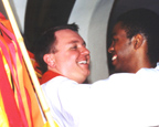 Jay Wiesner, left, receives an embrace from a participant at his ordination