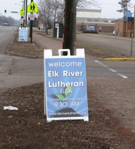 A sign welcomes members and visitors to the newly formed Elk River Lutheran Church.