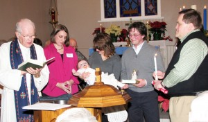 The Rev. Cedric Olson, pastor at Central Lutheran Church (formerly ELCA; currently LCMC), Elk River, Minnesota, for more than 30 years, presides over the baptism of members of Elk River Lutheran Church, the new start formed by former members of Central.