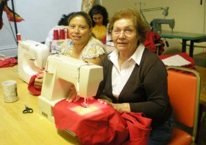 The women of St. Paul's sewing collective work on red vests for the ELCA churchwide assembly held in Minneapolis in August 2009.