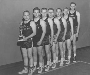 The Holy Trinity Lutheran Church basketball team often won citywide church league  tournaments in the 1950s, primarily due to the participation of seven-foot center John Pritchard (right). The local newspapers at the time regularly reported the scores of church league games,  according to John Kelly, a former president of  the Church Athletics Association. Photo provided by Carol Johnson