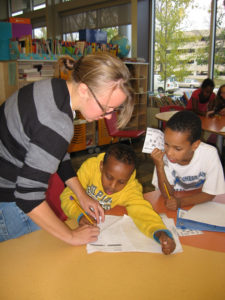 A Kaleidoscope Place volunteer helps a couple of students with their writing assignments as part of the after-school program. Photos provided by Kaleidoscope Place