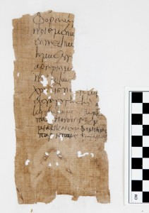 This papyrus fragment was discovered in a plastic bag inside a book that had been packed in a box of the Luther College Archives.