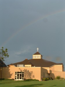 A faint rainbow arcs over Advent Lutheran Church in Maple Grove, Minnesota, last summer. Members of Advent Lutheran Church hosted an unexpected and unusual commitment ceremony several months ago. Photo provided by Susan McKenzie.
