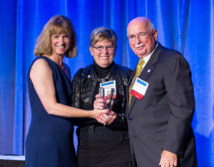 """Barb and Chuck Swanson, members of Diamond Lake Lutheran Church in Minneapolis, were presented the 2013 Changing Lives Award by LSSCEO Jodi Harpstead at the LSS gala in September """"for their impact on LSS and the people we serve through a  combination of volunteering, advocacy and philanthropy."""" Photo courtesy of Lutheran Social Service of Minnesota"""