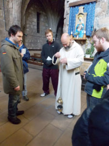Father Giles, a monk at Pluscarden Abbey, Scotland, explains the use of the thurible (incense dispenser) to Augsburg students Alex Rhees (left), Matt Current (center), and Brent Howart (right). Photos courtesy of Emily Gilmer