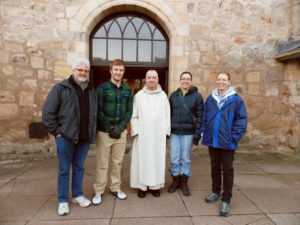 From left: Professor Phil Adamo, director of Medieval studies at Augsburg College; Matt Current;  Father Bede, Guestmaster at Pluscarden Abbey; Amber Kalina; and Julie Fedeler stand in front of  the Pluscarden Abbey in rural Scotland.