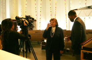 A Mankato, Minnesota, television reporter interviews Diane Nash at the conclusion of her Martin Luther King Jr. Memorial Lecture at Gustavus Adolphus College, St. Peter, Minnesota. Nash was co-founder of the Student Nonviolent Coordinating Committee and the strategist for several sit-ins in the 1960s Civil Rights Movement. Photo credit: Bob Hulteen